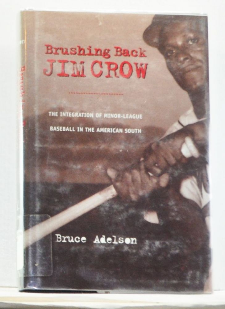 Brushing Back Jim Crow: The Integration of Minor-League Baseball in the American South. Bruce Adelson.